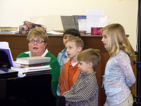 "Sis. Janna Riley sings with the ""Little Lifers"" at their first rehearsal, Feb. 15, 2009."